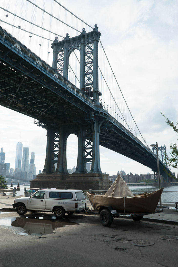 Boat in DUMBO under the Manhattan Bridge in Brooklyn
